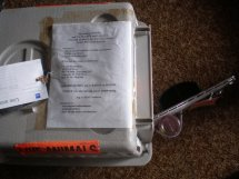 Place the paperwork pocket on the kennel, in a sheet cover taped to the top. It contains the contact phone numbers at both ends of the trip, and copies of the paperwork.